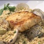 Disfruta un rico arroz con mero y almejas